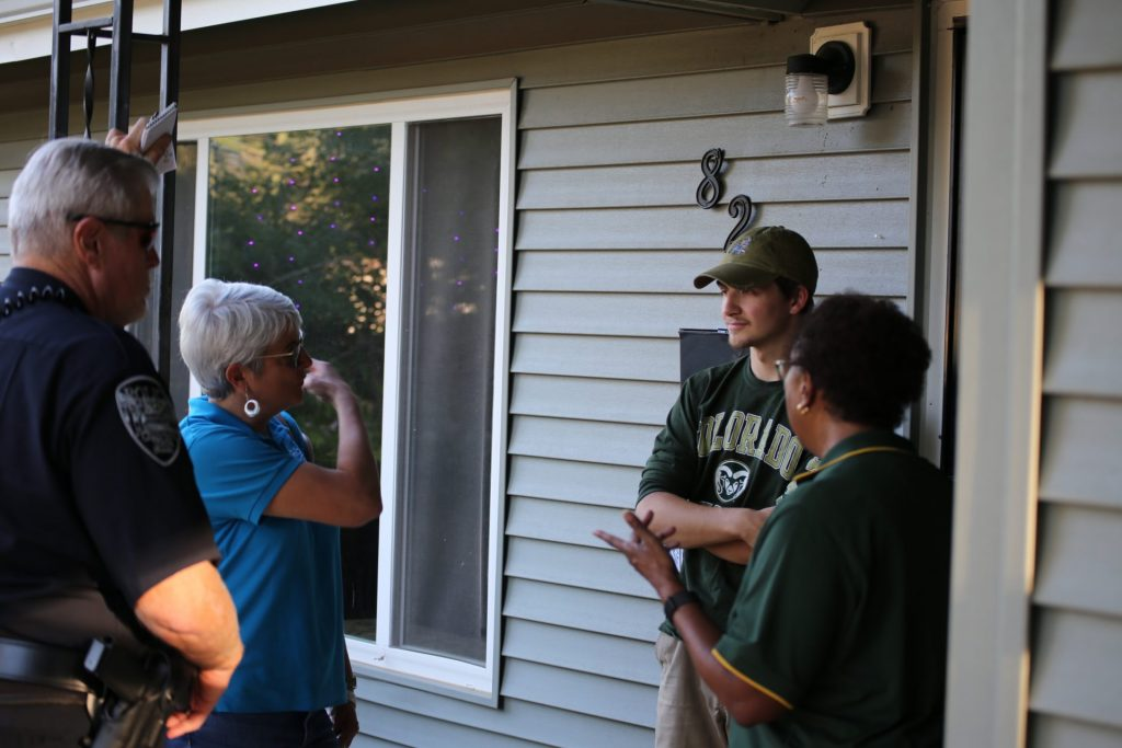 A group chatting with a neighbor during Community Welcome